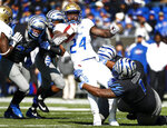Memphis defense brings down Tulsa running back Corey Taylor II during an NCAA college football game in Memphis, Tenn., Saturday, Nov. 10, 2018. (Mark Weber/The Commercial Appeal via AP)