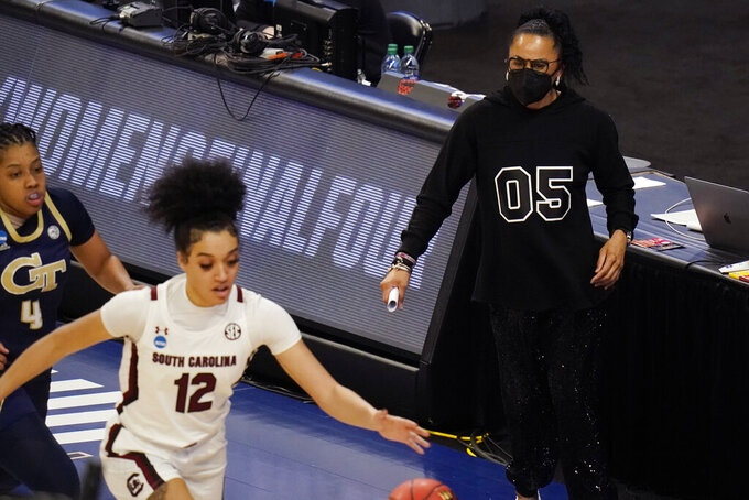 South Carolina head coach Dawn Stanley, right, watches guard Brea Beal (12) drive to the basket during the second half of a college basketball game against Georgia Tech in the Sweet Sixteen round of the women's NCAA tournament at the Alamodome in San Antonio, Sunday, March 28, 2021. (AP Photo/Eric Gay)