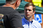 In this Saturday, Sept. 21, 2019, photo, Democratic candidate for governor, Kentucky Attorney General Andy Beshear, right, talks with a supporter before the start of the Black Gold Festival Parade in Hazard, Ky. (AP Photo/Timothy D. Easley)