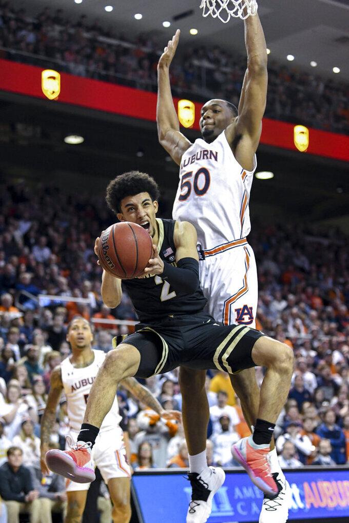 Auburn center Austin Wiley (50) blocks a shot by Vanderbilt guard Scotty Pippen Jr. (2) during the first half of an NCAA college basketball game Wednesday, Jan. 8, 2020, in Auburn, Ala. (AP Photo/Julie Bennett)