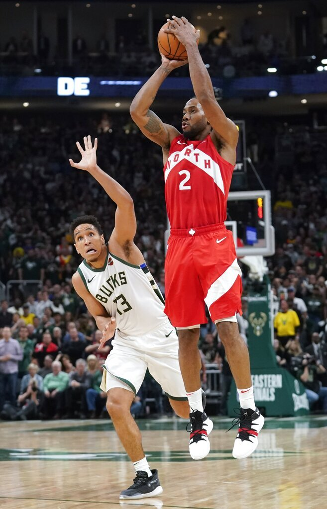 Toronto Raptors' Kawhi Leonard shoots in front of Milwaukee Bucks' Malcolm Brogdon during the second half of Game 5 of the NBA Eastern Conference basketball playoff finals Thursday, May 23, 2019, in Milwaukee. The Raptors won 105-99 to take a 3-2 lead in the series. (AP Photo/Morry Gash)