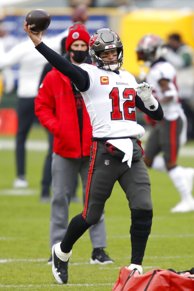 Tampa Bay Buccaneers quarterback Tom Brady warms up before the NFC championship NFL football game against the Green Bay Packers in Green Bay, Wis., Sunday, Jan. 24, 2021. (AP Photo/Matt Ludtke)