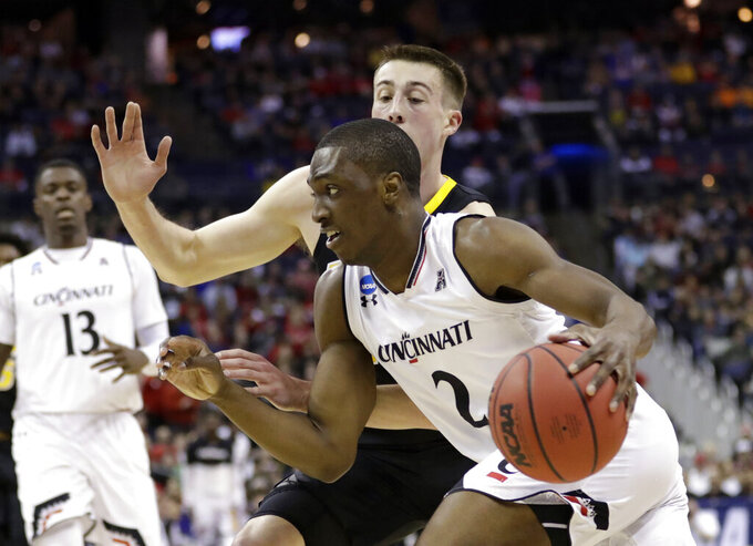 Cincinnati's Keith Williams (2) drives past Iowa's Joe Wieskamp (10) in the first half during a first round men's college basketball game in the NCAA Tournament in Columbus, Ohio, Friday, March 22, 2019. (AP Photo/Tony Dejak)
