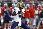 Akron quarterback DJ Irons drops back to pass against Ohio State during the first half of an NCAA college football game Saturday, Sept. 25, 2021, in Columbus, Ohio. (AP Photo/Jay LaPrete)