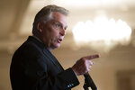 FILE - In this Wednesday, Sept. 1, 2021, file photo, Virginia Democratic gubernatorial candidate Terry McAuliffe addresses the Virginia FREE Leadership Luncheon in McLean, Va. McAuliffe has generally led in public polling, but recent surveys have suggested his lead is tightening. His race against Glenn Youngkin is one of the country's most competitive and closely watched political matchups of the year. (AP Photo/Cliff Owen, File)
