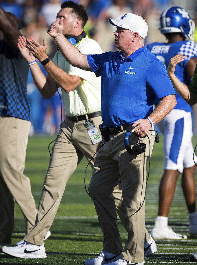 Kentucky head coach Mark Stoops shouts directions to his team during the second half of an NCAA college football game against Central Michigan in Lexington, Ky., Saturday, Sept. 1, 2018. (AP Photo/Bryan Woolston)