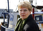 """FILE - In this March 2, 2010, file photo, National Oceanic and Atmospheric Administration, NOAA, chief, Jane Lubchenco looks out from the waterfront as she speaks to fisherman in Gloucester, Mass. A new 46-person federal scientific integrity task force with members from dozens of government agencies will meet for the first time Friday, May 14, 2021. """"We want people to be able to trust what the federal government is telling you, whether it's a weather forecast or information about vaccine safety or whatever,"""" said Lubchenco, the deputy director for climate and environment at the White House Office of Science and Technology Policy. (AP Photo/Mary Schwalm, File)"""