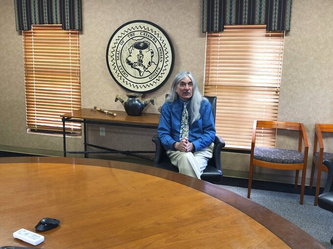 FILE - In this April 26, 2019 file photo, Catawba Indian Nation Chief Bill Harris talks about how his South Carolina-based tribe is trying to get permission to build a casino in North Carolina but is getting heavy opposition from the Eastern Band of Cherokee Indians, during an interview at the Catawba's reservation near Rock Hill, S.C. A federal judge on Friday rejected a legal challenge from the Eastern Band trying to stop the planned Catawba casino near Kings Mountain, North Carolina. (AP Photo/Jeffrey Collins, File)
