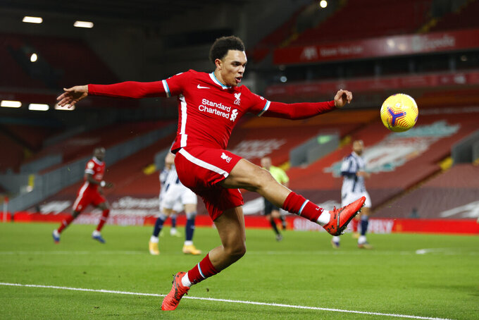 Liverpool's Trent Alexander-Arnold kicks the ball during an English Premier League soccer match between Liverpool and West Bromwich Albion at the Anfield stadium in Liverpool, England, Sunday Dec. 27, 2020. (Clive Brunskill/Pool via AP)