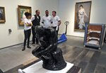 The staff removed the Rodin's Thinker bronze statue from it's package to install it at the Louvre Museum in Abu Dhabi, United Arab Emirates, Sunday, Oct. 27, 2019. The 1881-2 made statue is on a one year loan from Rodin museum in France (AP Photo/Kamran Jebreili)