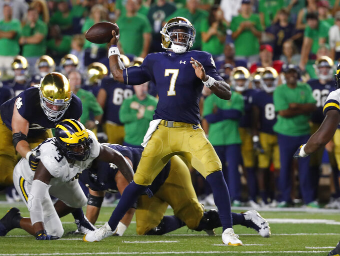 Notre Dame quarterback Brandon Wimbush (7) throws against the Michigan in the first half of an NCAA football game in South Bend, Ind., Saturday, Sept. 1, 2018. (AP Photo/Paul Sancya)