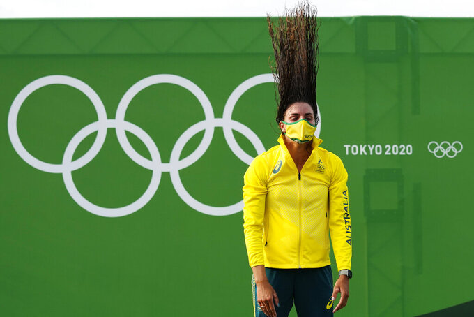 Jessica Fox of Australia throws back her hair during the medal ceremony after winning gold in the women's C1 in the canoe slalom at the 2020 Summer Olympics, Thursday, July 29, 2021, in Tokyo, Japan. (AP Photo/Kirsty Wigglesworth)