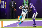 Minnesota Vikings cornerback Chris Jones, right, breaks up a pass intended for Carolina Panthers wide receiver DJ Moore, left, during the second half of an NFL football game, Sunday, Nov. 29, 2020, in Minneapolis. (AP Photo/Jim Mone)