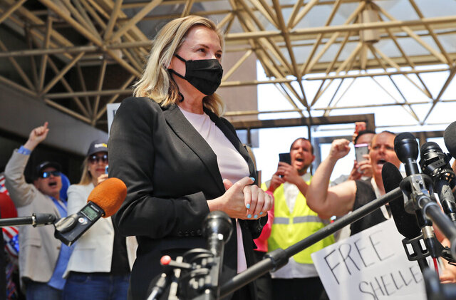 Salon owner Shelley Luther begins to speak to the media after she was released from jail in Dallas, Thursday, May 7, 2020. Luther was jailed for refusing to keep her business closed amid concerns of the spread of COVID-19. (AP Photo/LM Otero)