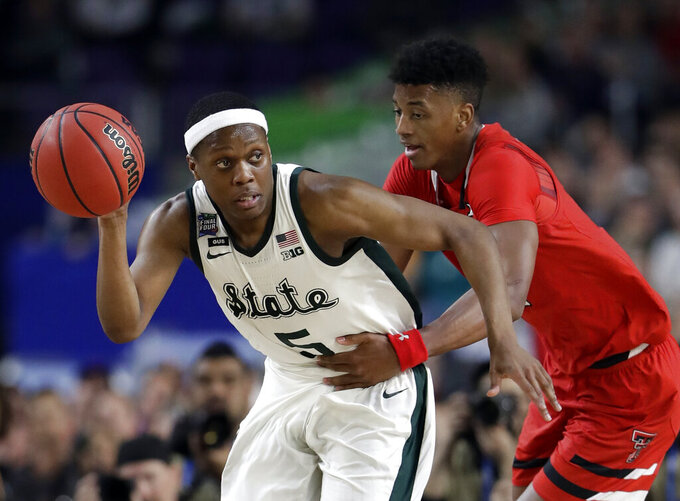 Michigan State's Cassius Winston (5) drives against Texas Tech's Jarrett Culver during the second half in the semifinals of the Final Four NCAA college basketball tournament, Saturday, April 6, 2019, in Minneapolis. (AP Photo/Jeff Roberson)