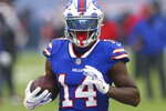 FILE - In this Monday Oct. 19, 2020 file photo,Buffalo Bills receiver Stefon Diggs (14) warms up prior to the first half of an NFL football game against the Kansas City Chiefs in Orchard park, N.Y. Buffalo's Stefon Diggs and Arizona's DeAndre Hopkins are two receivers who have flourished in their new homes after being traded to their respective teams just hours apart in March. The Bills travel to face the Cardinals in a game that's vital for both teams in their chase for the playoffs, Sunday,  Nov. 15, 2020.  (AP Photo/ Jeffrey T. Barnes)