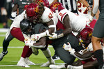 owa State linebacker Dae'Shawn Davis (43) tackles UNLV running back Charles Williams (8) during the second half of an NCAA college football game Saturday, Sept. 18, 2021, in Las Vegas. (AP Photo/John Locher)