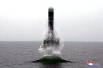 FILE - In this Oct. 2, 2019, file photo provided by the North Korean government, an underwater-launched missile lifts off in the waters off North Korea's eastern coastal town of Wonsan, North Korea. For months, North Korea has been relatively uncombative, as leader Kim Jong Un grapples with the coronavirus pandemic, a string of natural disasters and the deepening economic pain from years of tough U.S.-led sanctions. Korean language watermark on image as provided by source reads: