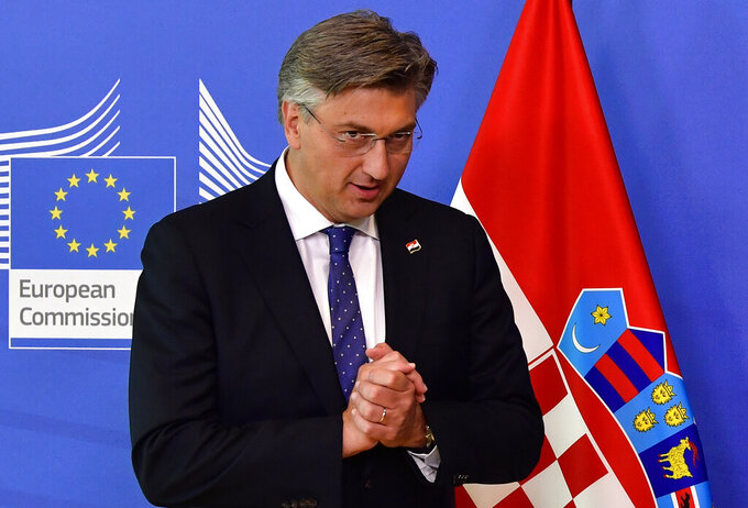 FILE - In this Thursday, July 16, 2020 file photo, Croatian Prime Minister Andrej Plenkovic arrives for a meeting with European Commission President Ursula von der Leyen at EU headquarters in Brussels. Croatia's president on Thursday handed Prime Minister Andrej Plenkovic the mandate to form a new government after his conservative party prevailed in a July 5 parliamentary election. (John Thys, Pool Photo via AP, file)