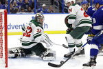 Minnesota Wild goaltender Alex Stalock (32) looks back after his save on a shot by the Tampa Bay Lightning during the second period of an NHL hockey game Thursday, Dec. 5, 2019, in Tampa, Fla. (AP Photo/Chris O'Meara)