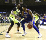 Kansas forward Dedric Lawson (1) drives the ball against Baylor forward Freddie Gillespie (33) in the second half of an NCAA college basketball game, Saturday, Jan. 12, 2019, in Waco, Texas. (AP Photo/Jerry Larson)