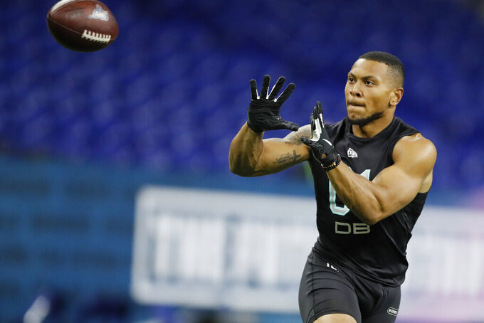 FILE - In this March 1, 2020, file photo, Minnesota defensive back Antoine Winfield Jr. runs a drill at the NFL football scouting combine in Indianapolis. Winfield was selected by the Tampa Bay Buccaneers in the second round of the NFL football draft Friday, April 24, 2020. (AP Photo/Charlie Neibergall, File )