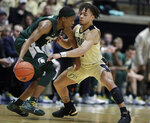 Purdue guard Carsen Edwards (3) defends Michigan State guard Cassius Winston (5) during the second half of an NCAA college basketball game in West Lafayette, Ind., Sunday, Jan. 27, 2019. (AP Photo/Michael Conroy)
