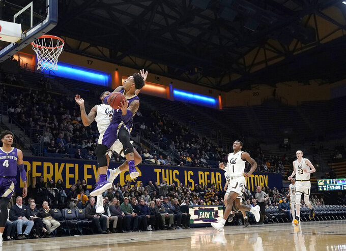 Washington guard David Crisp drives to the basket against California guard Paris Austin (3) during the first half of an NCAA college basketball game Thursday, Feb. 28, 2019, in Berkeley, Calif. (AP Photo/Tony Avelar)