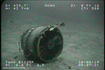 ADDS ADDITIONAL SOURCE INFORMATION - In this Thursday, July 8, 2021, image from video provided by Sea Engineering, Inc. via the National Transportation Safety Board, the jet engine inlet case from Transair Flight 810 rests on the Pacific Ocean floor off the coast of Honolulu, Hawaii. The NTSB located the aircraft on the Pacific Ocean floor approximately 2 miles from Ewa Beach. The fuselage split into 2 sections, breaking just forward of the wings. On July 2, the pilots of the Transair Flight 810 reported engine trouble and were attempting to return to Honolulu when they were forced to land the Boeing 737 in the water, the Federal Aviation Administration said in a statement. (Sea Engineering, Inc./NTSB via AP)