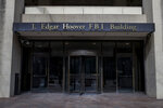 FILE - In this March 4, 2019, file photo, the J. Edgar Hoover FBI Building is seen in Washington. The FBI, in a change of policy, is committing to inform state officials if local election systems have been breached, federal officials told The Associated Press. (AP Photo/Alex Brandon, File)