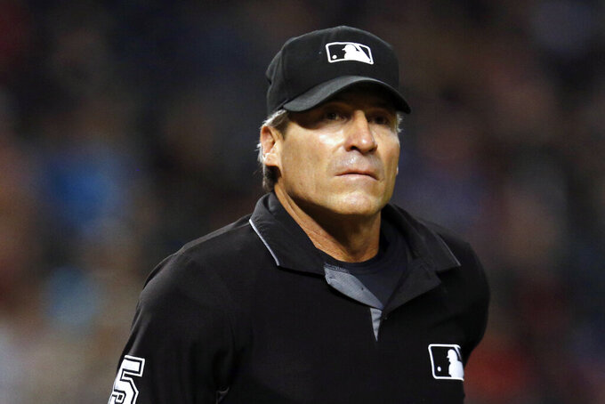 FILE - In this Sept. 3, 2018, file photo, umpire Angel Hernandez (5) is seen in the first inning during a game between the Arizona Diamondbacks the San Diego Padres, in Phoenix. Umpire Ángel Hernández lost his lawsuit against Major League Baseball alleging racial discrimination. The Cuba-born Hernández sued in 2017 in U.S. District Court in Cincinnati, a case later moved to New York. Hired as a big league umpire in 1993, he alleged he was discriminated against because he had not been assigned to the World Series since 2005 and had been passed over for crew chief.  (AP Photo/Rick Scuteri, File)