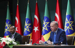 Turkish President Recep Tayyip Erdogan, right, and Ethiopian Prime Minister Abiy Ahmed speak to the media at a joint news conference in Ankara, Turkey, Wednesday, Aug. 18, 2021. Erdogan urged Wednesday a peaceful resolution of the Tigray conflict in Ethiopia and also said his country was willing to mediate between Addis Ababa and Sudan for a resolution of a border dispute.(Turkish Presidency via AP, Pool)
