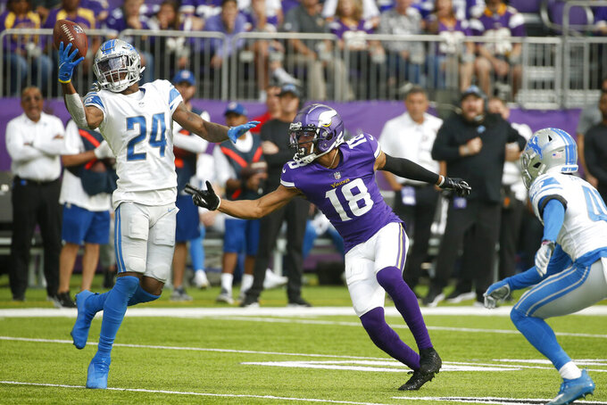Detroit Lions cornerback Amani Oruwariye (24) breaks up a pass intended for Minnesota Vikings wide receiver Justin Jefferson (18) during the first half of an NFL football game, Sunday, Oct. 10, 2021, in Minneapolis. (AP Photo/Bruce Kluckhohn)