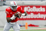 FILE - In this Sept. 22, 2018, file photo, Ohio State quarterback Dwayne Haskins plays against Tulane during an NCAA college football game in Columbus, Ohio. The Heisman Trophy candidate leads the nation with 28 passing touchdowns and ranks among the top five in 10 other passing categories. (AP Photo/Jay LaPrete, file)