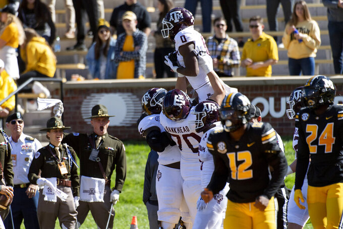 Texas A&M wide receiver Ainias Smith, top is hoisted in the air after scoring a touchdown during the second quarter of an NCAA college football game against Missouri, Saturday, Oct. 16, 2021, in Columbia, Mo. (AP Photo/L.G. Patterson)