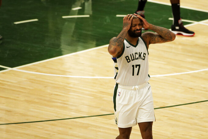 Milwaukee Bucks' P.J. Tucker reacts to a call during the first half of an NBA basketball game against the Brooklyn Nets Tuesday, May 4, 2021, in Milwaukee. (AP Photo/Aaron Gash)