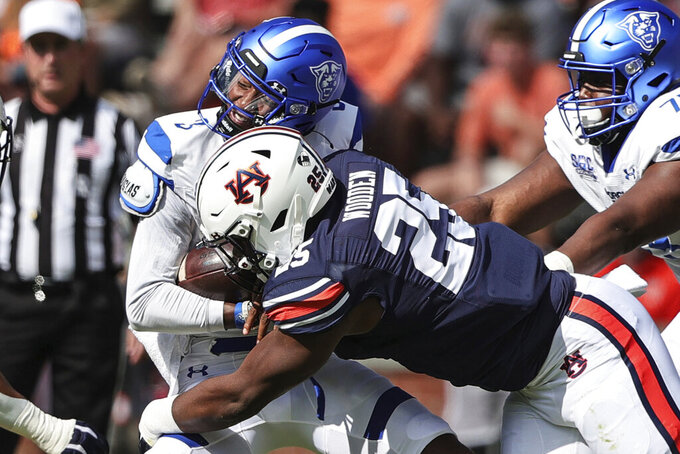 Georgia State quarterback Darren Grainger (3) is tacked by Auburn defensive end Colby Wooden (25) as he carries the ball during the first half of an NCAA football game Saturday, Sept. 25, 2021, in Auburn, Ala. (AP Photo/Butch Dill)