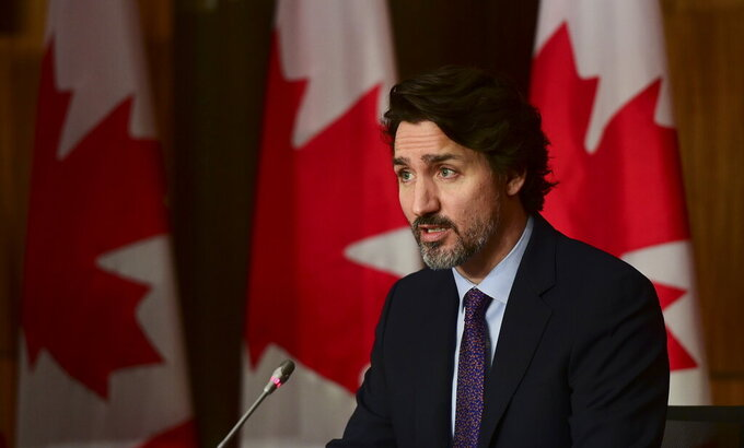 Canada Prime Minister Justin Trudeau speaks during a press conference in Ottawa, Friday, April 23, 2021, during the COVID-19 pandemic. (Sean Kilpatrick/The Canadian Press via AP)
