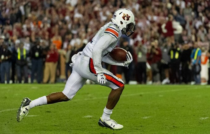 Auburn wide receiver Darius Slayton gets loose for a touchdown reception against Alabama during the second half of an NCAA college football game Saturday, Nov. 24, 2018, in Tuscaloosa, Ala. (AP Photo/Vasha Hunt)