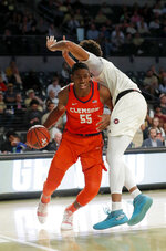 Clemson center Trey Jemison (55) drives against Georgia Tech forward James Banks III (1) during the first half of an NCAA college basketball Wednesday, Feb. 6, 2019, in Atlanta. (AP Photo/John Bazemore)