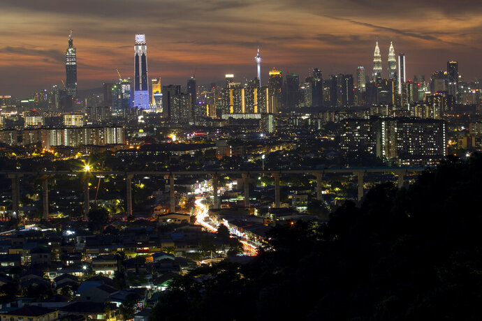 This photo shows a night view of city center in Kuala Lumpur, Malaysia on Aug. 10, 2020. Malaysia has reported its economy contracted 17% in the last quarter in its worst downturn since the global financial crisis. (AP Photo/Vincent Thian)