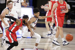Dixie State guard Cameron Gooden, left, and Gonzaga guard Aaron Cook go after the ball during the first half of an NCAA college basketball game in Spokane, Wash., Tuesday, Dec. 29, 2020. (AP Photo/Young Kwak)