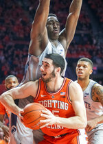 Illinois forward Giorgi Bezhanishvili (15) looks to shoot as Penn State' forward Mike Watkins (24) defends during the first half of an NCAA college basketball game in Champaign, Ill., Saturday, Feb. 23, 2019.(AP Photo/Robin Scholz)