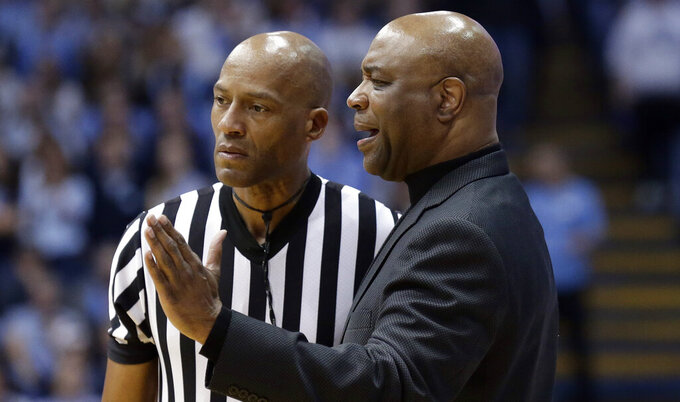 Florida State head coach Leonard Hamilton, right, speaks with an official during the first half of an NCAA college basketball game against North Carolina in Chapel Hill, N.C., Saturday, Feb. 23, 2019. (AP Photo/Gerry Broome)