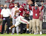 Alabama running back Jase McClellan (21) scores a touchdown against Kentucky during an NCAA college football game Saturday, Nov. 21, 2020, in Tuscaloosa, Ala. (Mickey Welsh/The Montgomery Advertiser via AP)