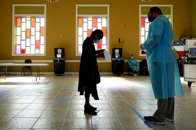A woman waits to vote at the Cathedral of Praise church on Election Day Tuesday, Nov. 3, 2020, in Nashville, Tenn. (AP Photo/Mark Humphrey)