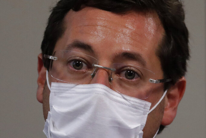 Fabio Wajngarten, former Communications Secretary, testifies during a Brazilian Senate commission inquiry investigating the government's management of the COVID-19 pandemic, in Brasilia, Brazil, Wednesday, May 12, 2021.  Wajngarten is an ally of President Jair Bolsonaro, who has been one of the world's most prominent opponents of restrictions aimed at curbing the disease. (AP Photo/Eraldo Peres)