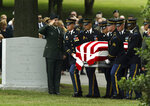 FILE - In this July 13, 2004, file photo, the casket of Army Maj. Paul Syverson III is brought by members of the Old Guard to Arlington National Cemetery in Arlington, Va. Syverson was killed in Balad, Iraq on June 16. Then-U.S. President George W. Bush boasted that Iraq would become a model of democracy in a region ruled by dictators. Instead, the country fell into protracted war between Sunnis and Shiites in which tens of thousands of people died. (AP Photo/Evan Vucci, File)