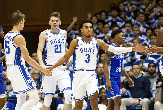 Duke's Tre Jones (3) celebrates with teammates after a play during the first half of the team's NCAA college basketball game against Georgia State in Durham, N.C., Friday, Nov. 15, 2019. (AP Photo/Ben McKeown)