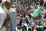 Algerian protesters gather during an anti-government demonstration in the centre of the capital Algiers, Algeria, Friday, June 14, 2019. Algeria is in the midst of an unprecedented anti-corruption crusade, sparked by a people's revolt in February and prompting many lawmakers to be questioned over allegations. (AP Photo/Anis Belghoul)